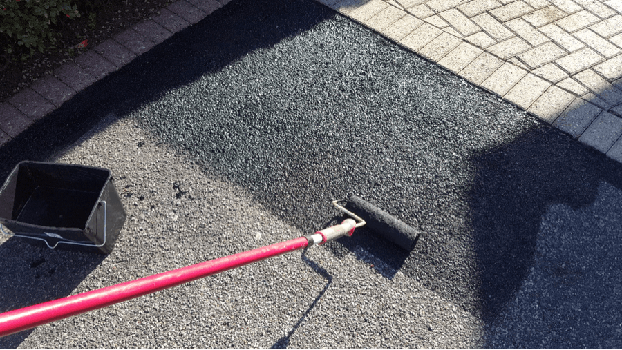 Then we use a roller to apply the tarmac restorer and protector